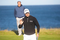 1st October 2021; Kingsbarns Golf Links, Fife, Scotland; European Tour, Alfred Dunhill Links Championship, Second round; Martin Kaymer of Germany reacts to the applause of the crowd after sinking a putt on the seventh green at Kingsbarns Golf Links