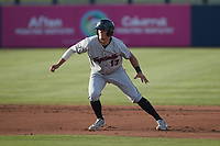 Nathan Perry (17) of the Fayetteville Woodpeckers takes his lead off of second base against the Kannapolis Cannon Ballers at Atrium Health Ballpark on June 22, 2021 in Kannapolis, North Carolina. (Brian Westerholt/Four Seam Images)