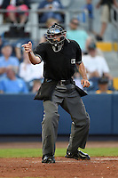Home plate umpire Alex McKay makes a call during a game between the Bradenton Marauders and Charlotte Stone Crabs on April 4, 2014 at Charlotte Sports Park in Port Charlotte, Florida.  Bradenton defeated Charlotte 9-1.  (Mike Janes/Four Seam Images)