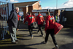Gornal Athletic 4 Wisbech Town 2, 02/02/2013. Garden Walk Stadium, FA Vase 4th round. A groundsman watching the players of Wisbech Town arriving at Garden Walk Stadium, prior to their FA Vase 4th round tie at Gornal Athletic from Dudley in the West Midlands. Gornal, from the Midland Alliance and appearing for the first time at this stage of the tournament, defeated Wisbech, who play in the Eastern Counties League, by 4-2 after extra-time, after the visitors had lead two-nil after 10 minutes. The FA Vase was a nationwide, non-League English football tournament for semi-professional clubs and the winner of this tie played away at Bodmin Town in the next round. Photo by Colin McPherson.