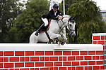 August 08, 2009: Jur Vrieling (NED) aboard Pegasus jump the wall. Land Rover International Puissance. Failte Ireland Horse Show. The RDS, Dublin, Ireland.