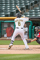 Josh Rutledge (8) of the Salt Lake Bees at bat against the Tacoma Rainiers in Pacific Coast League action at Smith's Ballpark on May 7, 2015 in Salt Lake City, Utah. The Bees defeated the Rainiers 11-4 in the completion of the game that was suspended due to weather on May 6, 2015.(Stephen Smith/Four Seam Images)