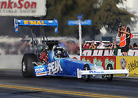 Feb. 14, 2013; Pomona, CA, USA; NHRA top fuel dragster driver T.J. Zizzo during qualifying for the Winternationals at Auto Club Raceway at Pomona.. Mandatory Credit: Mark J. Rebilas-
