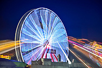 Ocean City Maryland--the iconic Ferris wheel appears to be shooting light rays as it spins.