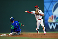 Shortstop Ryan Fitzgerald (24) of the Greenville Drive turns a double play as Sebastian Rivero (3) the Lexington Legends is out on Sunday, September 2, 2018, at Fluor Field at the West End in Greenville, South Carolina. Greenville won, 7-4. (Tom Priddy/Four Seam Images)