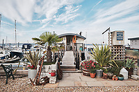 BNPS.co.uk (01202 558833)<br /> Pic: Aucoot/BNPS<br /> <br /> House Boat Heaven...<br /> <br /> It  comes with its own tidal mooring in Gosport<br /> <br /> A former coal barge that has been converted into a stylish two storey houseboat has emerged for sale for £400,000.<br /> <br /> Liverpool 91 comes with its own tidal mooring in Gosport, Hants, which enjoys stunning breathtaking sea views across the Solent.<br /> <br /> On one side of the spot is Portsmouth - home of the Royal Navy - while on the other the Isle of Wight.<br /> <br /> It was transformed by the current owners around six years ago and they have lived on the vessel ever since.