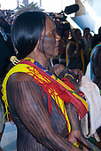 Altamira, Brazil. Kayapo woman with her child at the Encontro Xingu protest meeting about the proposed Belo Monte hydroeletric dam and other dams on the Xingu river and its tributaries.