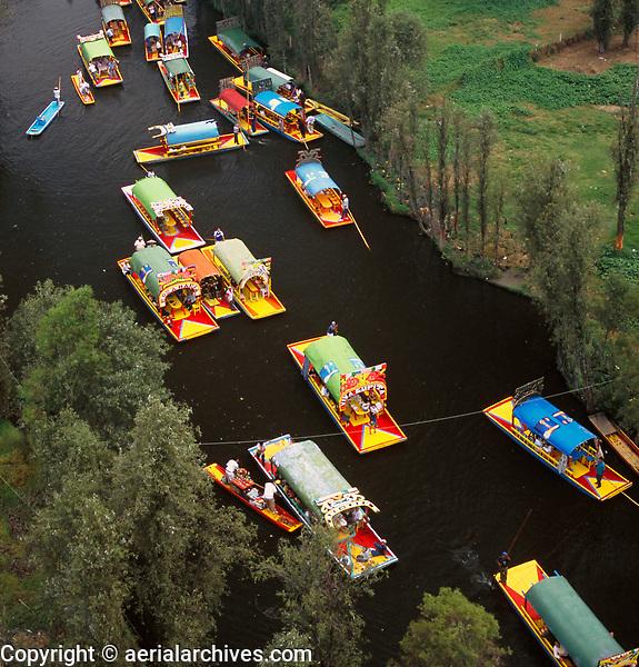aerial photograph of trajinera gondola like boats floating on the edge of the Xochimilco canals, Mexico City, Mexico | fotografía aérea de barcos flotando en el borde de los canales de Xochimilco, Ciudad de México, México