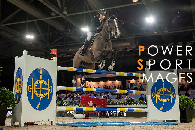 John Whitaker of United Kingdom riding Ornellaia during the Hong Kong Jockey Club Trophy competition, part of the Longines Masters of Hong Kong on 10 February 2017 at the Asia World Expo in Hong Kong, China. Photo by Marcio Rodrigo Machado / Power Sport Images