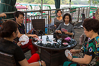 Wenzhou, Zhejiang, China.  Jiangxin Island, Women Playing Cards.