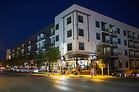 In this image, East Austin's revitalization has brought a barrage of new creative and cultural mixed use spaces including restaurants, shops, and service industries. Mixed use retail apartment building on east 6th Street - Stock Image.
