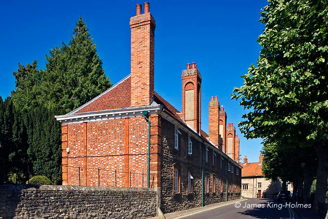 The distinctive chimney stacks of the Brick Alley almshouses in Abingdon-on-Thames, Oxfordshire, UK. The almshouses were built in 1718, replacing an earlier almshouse with the work costing a total of £632. The almshouses are administered  by the Christ's Hospital charity, founded in 1553 and continue to be occupied by elderly residents of the local area. Abingdon was situated in the county of Berkshire, but under local government re-organisation in 1974 it was transferred to Oxfordshire.