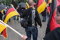 """Knapp 100 Mitglieder und Anhaenger der sog. """"Identitaeren"""" demonstrierten am Freitag den 17. Juni 2016 in Berlin. Angemeldet waren laut Veranstalter 400 Teilnehmer. Die rechtsextremen Teilnehmer des Aufmarsches kamen aus Berlin, Bayern und Oestrreich und skandierten Parolen wie """"Berlin ist unsere Stadt"""", """"Festung Europa, macht die Grenzen dicht"""" und No Border, No Nation, Stop Immigration"""".<br /> Im Bild: Ein Aufmarschteilnehmer mit der Aufschrift """"Ostdeutsch simply the best"""" auf dem Pullover.<br /> 17.6.2016, Berlin<br /> Copyright: Christian-Ditsch.de<br /> [Inhaltsveraendernde Manipulation des Fotos nur nach ausdruecklicher Genehmigung des Fotografen. Vereinbarungen ueber Abtretung von Persoenlichkeitsrechten/Model Release der abgebildeten Person/Personen liegen nicht vor. NO MODEL RELEASE! Nur fuer Redaktionelle Zwecke. Don't publish without copyright Christian-Ditsch.de, Veroeffentlichung nur mit Fotografennennung, sowie gegen Honorar, MwSt. und Beleg. Konto: I N G - D i B a, IBAN DE58500105175400192269, BIC INGDDEFFXXX, Kontakt: post@christian-ditsch.de<br /> Bei der Bearbeitung der Dateiinformationen darf die Urheberkennzeichnung in den EXIF- und  IPTC-Daten nicht entfernt werden, diese sind in digitalen Medien nach §95c UrhG rechtlich geschuetzt. Der Urhebervermerk wird gemaess §13 UrhG verlangt.]"""