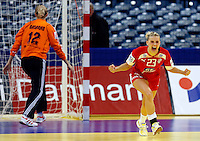 BELGRADE, SERBIA - DECEMBER 15:  Ann Grete Norgaard(R) of Denmark celebrates the score past goalkeeper Maria Basarab of Russia (R) during the Women's European Handball Championship 2012 fifth place match between Denmark and Russia at Arena Hall on December 15, 2012 in Belgrade, Serbia. (Photo by Srdjan Stevanovic/Getty Images)