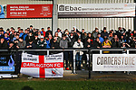 Darlington fans in The Tin Shed End. Darlington 1883 v Southport, National League North, 16th February 2019. The reborn Darlington 1883 share a ground with the town's Rugby Union club. <br />