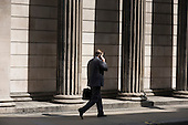 Man using a mobile phone outisde the Bank of England, Threadneedle Street, City of London.