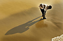 child and shadow on the beach