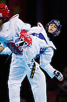 10 AUG 2012 - LONDON, GBR - Seham el-Sawalhy (EGY) (right) of Egypt battles with Elin Johansson of Sweden during their women's -67kg category preliminary round Taekwondo contest at the London 2012 Olympic Games at Excel in London, Great Britain .(PHOTO (C) 2012 NIGEL FARROW)