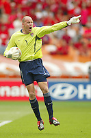 Brad Friedel organizes his defense. The USA tied South Korea, 1-1, during the FIFA World Cup 2002 in Daegu, Korea.