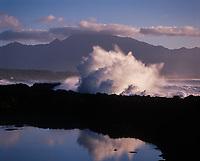 Huge Wave Crashing Against Coral Reef Into Tidepool, North Shore, Oahu, Hawaii, USA.
