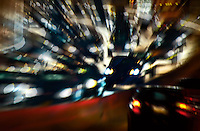 Heavy blurred traffic in a tunnel.