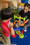 Education Preschool 3-4 year olds two boys playing together with marble run