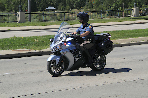 Motorcycle police officer riding in Denver, Colorado. .  John offers private photo tours in Denver, Boulder and throughout Colorado. Year-round Colorado photo tours.