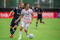 LAKE BUENA VISTA, FL - JULY 22: Donny Toia #4 of Real Salt Lake dribbles the ball during a game between Real Salt Lake and Sporting Kansas City at Wide World of Sports on July 22, 2020 in Lake Buena Vista, Florida.