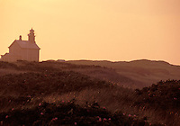 The setting sun casts a warm glow on hazy day at North Light