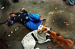 An underage sex worker lying passed out on the pavement because of binge drinking, after she had been abused by multiple clients the night before, in Watgunj red light district in Kolkata India. Crimes against women have been going on since centuries. In India, women have been categorically marginalized with various types of repressions enforced upon them. Be it home or outside, an Indian woman is potentially at the risk of being discriminated against, molested, raped and even killed. Until recently, turning a blind eye to such crimes has been the norm in largely gender-biased Indian society. But after the brutal gang rape and subsequent death of the Delhi Physiotherapy student, the so-far-silent middle class has turned vocal. .