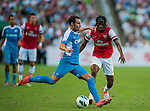 Gervais Yao Kouassi Gervinho of Arsenal FC and Daniel Cancela of Kichee in action during the pre-season Asian Tour friendly match at the Hong Kong Stadium on July 29, 2012. Photo by Victor Fraile / The Power of Sport Images