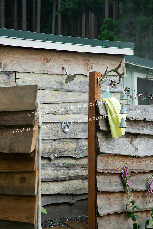 Built from reclaimed lumber, this unique outdoor shower is a short walk from a rustic waterfront cabin in the Pacific Northwest.