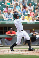 Ryan Brett (5) of the Charlotte Knights follows through on his swing against the Indianapolis Indians at BB&T BallPark on August 22, 2018 in Charlotte, North Carolina.  The Indians defeated the Knights 6-4 in 11 innings.  (Brian Westerholt/Four Seam Images)