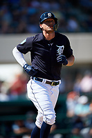 Detroit Tigers center fielder JaCoby Jones (21) runs to first base during a Grapefruit League Spring Training game against the Atlanta Braves on March 2, 2019 at Publix Field at Joker Marchant Stadium in Lakeland, Florida.  Tigers defeated the Braves 7-4.  (Mike Janes/Four Seam Images)