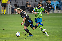 SAN JOSE, CA - OCTOBER 18: Tommy Thompson #22 of the San Jose Earthquakes is tackled by Cristian Roldan #7 of the Seattle Sounders during a game between Seattle Sounders FC and San Jose Earthquakes at Earthquakes Stadium on October 18, 2020 in San Jose, California.