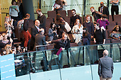 Security guards grapple with protesters as Switched On London environmental campaigners bring Mayor's Question Time to a standstill to demand Mayor Sadiq Khan keeps his climate promises. City Hall, London.