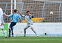 Forfar's Michael Bolochoweckyj knocks the ball past his own keeper Darren Hill for Ayr Utd's goal.