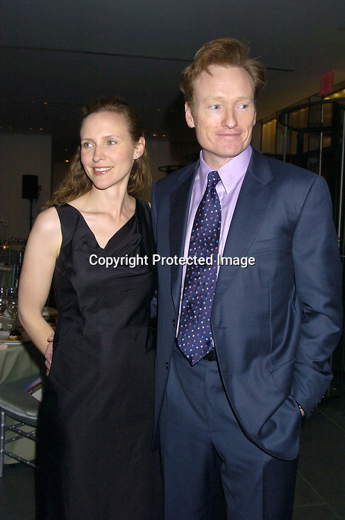 Liza and Conan O'Brien ..at the NYC and Company dinner honoring leaders in ..Tourism:  including American Express's Ken Chenault, ..NBC Universal's Bob Wright, Nicole Miller and Joseph Spinnato  on December 13, 2004 at the Museum of Modern ..Art. ..Photo by Robin Platzer, Twin Images