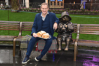 "Hugh Bonneville unveils a Paddington statue at the launch of ""Scenes in the Square"" statue trail in Leicester Square, London.<br /> <br /> ©Ash Knotek  D3558 27/02/2020"
