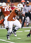 Texas Longhorns running back Cody Johnson (31) fakes a handoff during the game between the Oklahoma State Cowboys and the University of Texas in Austin Texas Longhorns at the Daryl K. Royal- Texas Memorial Stadium in Austin, Texas. The Oklahoma State Cowboys defeated the Texas Longhorns 33 to 16.