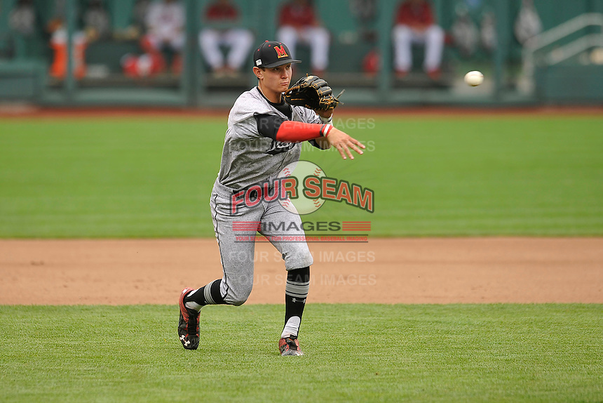 Maryland Terrapins shortstop Kevin Smith throws to first base during the Big Ten Tournament game against the Indiana Hoosiers at TD Ameritrade Park on May 25, 2016 in Omaha, Nebraska.  Maryland  won 5-3.  (Dennis Hubbard/Four Seam Images)