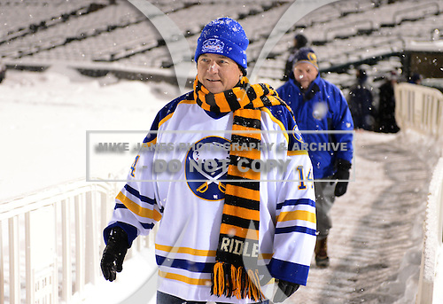 Honorary coach Rene Robert (14) walks to the rink before The Frozen Frontier Buffalo Sabres vs. Rochester Amerks Alumni Game at Frontier Field on December 15, 2013 in Rochester, New York.  (Copyright Mike Janes Photography)