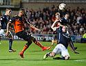 Dundee's James McPake blocks Dundee Utd's Mario Bilate shot.