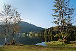 Austria, Tyrol, near Kitzbuhel: idyllic Schwarzsee (Black Lake) on the outskirts of Kitzbuhel