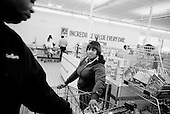 Cleveland, Ohio<br /> March 26, 2008 <br /> <br /> Michelle Fortson and her husband Reginald go family grocery shopping for the next three days. Michelle tightly controls the budget and searches for items that total no more then $30.<br /> <br /> Predatory lending has them in a position where they could loose their home soon.<br /> <br /> Reginald tries to slip in a couple of flowers in to the cart for his wife but Michelle asks him to put them back before checking out, saying that she knows he loves her.