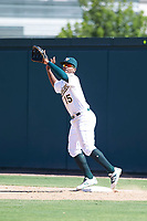 Oakland Athletics first baseman Alonzo Medina (15) leaps before catching an errant throw from third base during an Instructional League game against the Cincinnati Reds on September 29, 2017 at Lew Wolff Training Complex in Mesa, Arizona. (Zachary Lucy/Four Seam Images)