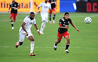 WASHINGTON, DC - AUGUST 25: Edison Flores #10 of D.C. United battles for the ball with Andrew Farrell #2 of New England Revolution during a game between New England Revolution and D.C. United at Audi Field on August 25, 2020 in Washington, DC.