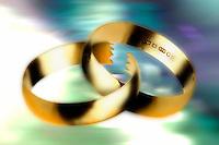 Split wedding rings denoting divorce.