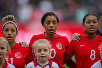 CARSON, CA - FEBRUARY 9: Desiree Scott #11, Ashley Lawerance #10, Jayde Riviere #8 of Canada during a game between Canada and USWNT at Dignity Health Sports Park on February 9, 2020 in Carson, California.