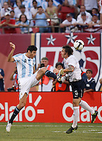 Argentina forward Julio Cruz (9) and United States defender Dan Califf (5). The men's national teams of the United States and Argentina played to a 0-0 tie during an international friendly at Giants Stadium in East Rutherford, NJ, on June 8, 2008.